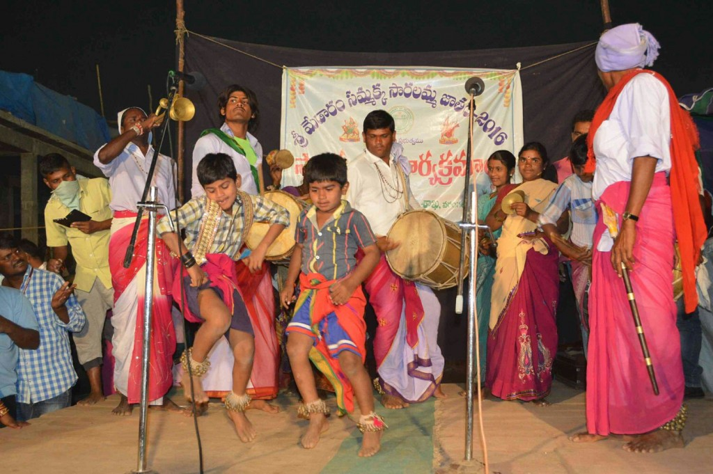 Child artists performing on stage