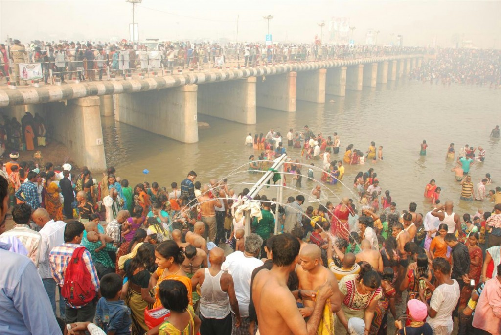 Devotees take bath in the Vaagu before visiting Goddeses (canal ).